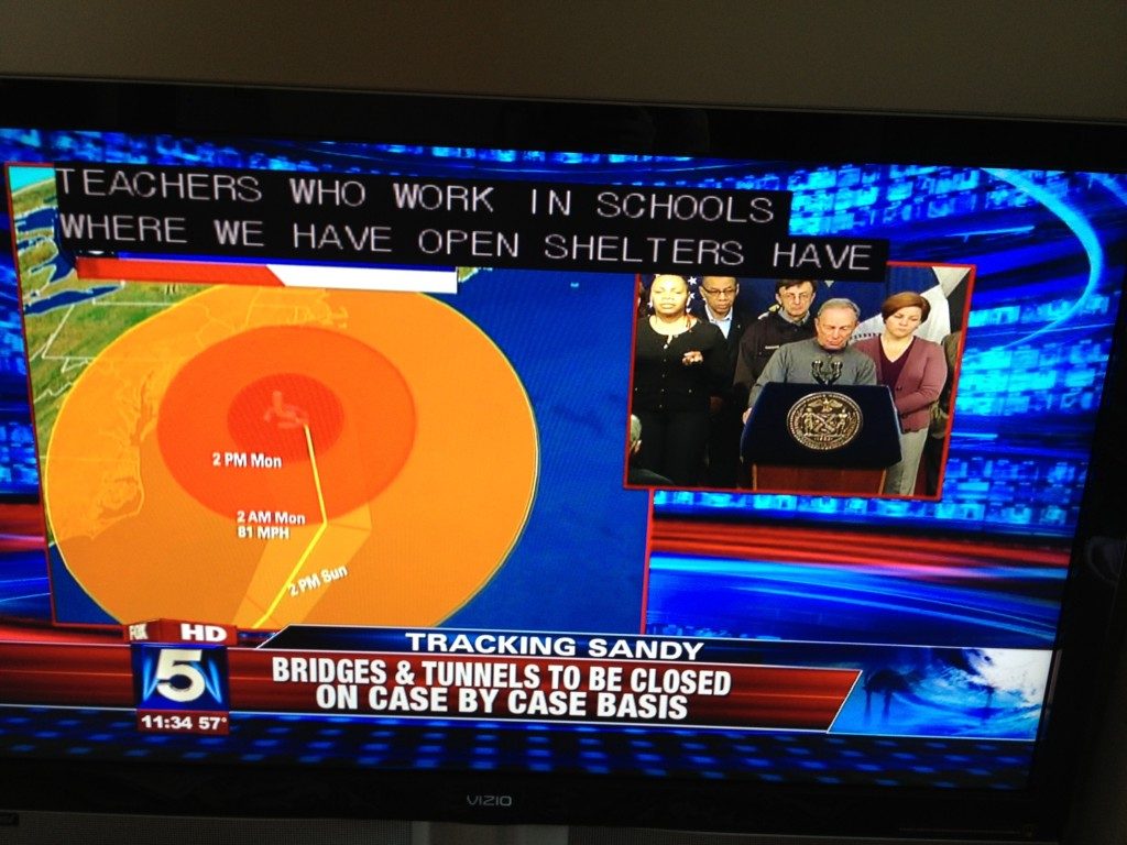 TV Screen of Sandy Coverage with captioning and ASL interpreting