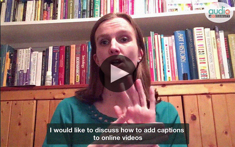 Screenshot of a video with Svetlana in front of camera and captions saying: I would like to discuss how to add captions to online videos