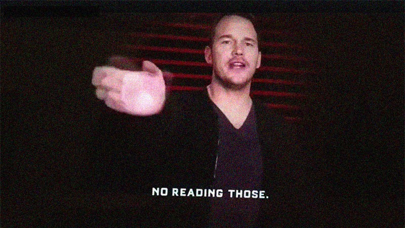 Chris Pratt with his hand about to swap the words: No reading those