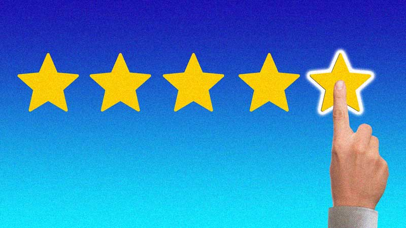 Blue background with 5 yellow stars and a hand pointed on the last star